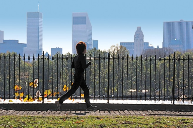 Man jogging in park, getting exercise benefits