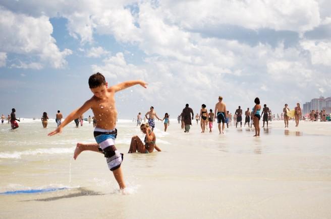 Boy running happily at beach