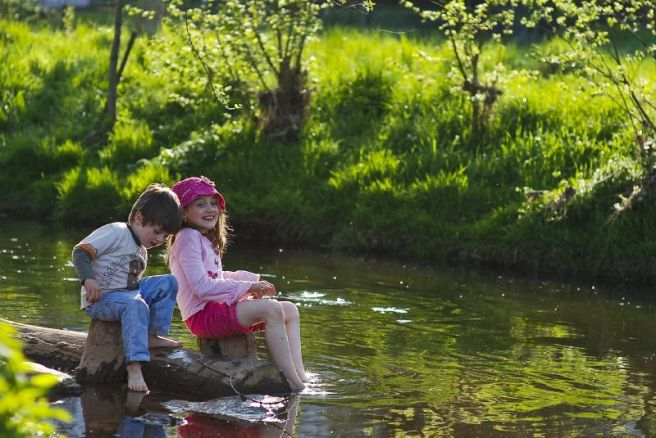 children playing in stream, nature